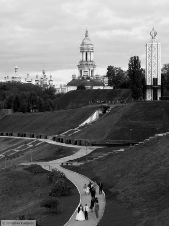 A couple get married in the grounds of the Kievo-Pecherska Lavra, Kyiv, Ukraine.